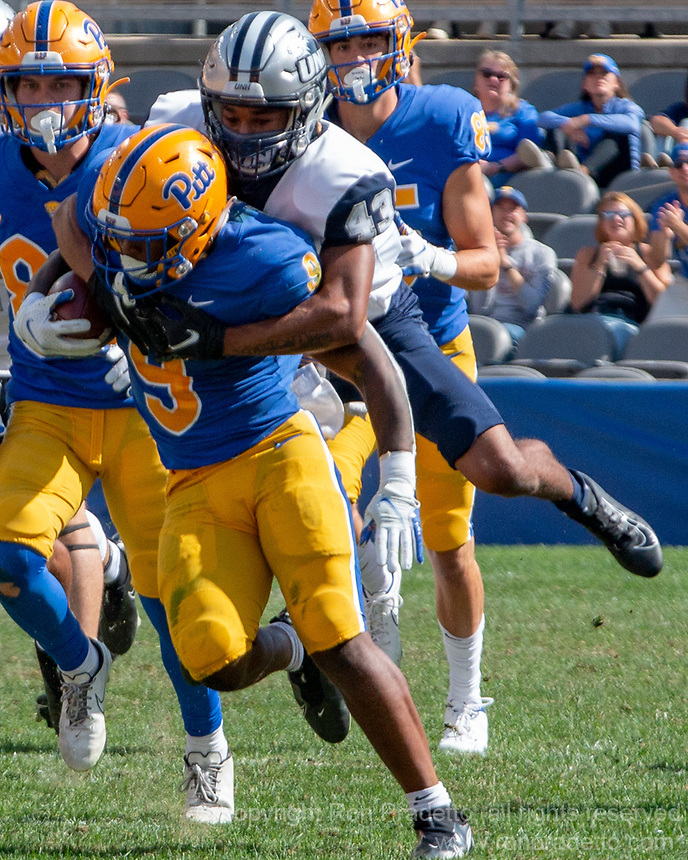 New Hampshire defensive back Tyrell Wiggins (43) tackles Pitt running back Rodney Hammond. The Pitt Panthers defeated the New Hampshire Wildcats 77-7 at Heinz Field, Pittsburgh, Pennsylvania on September 25, 2021.
