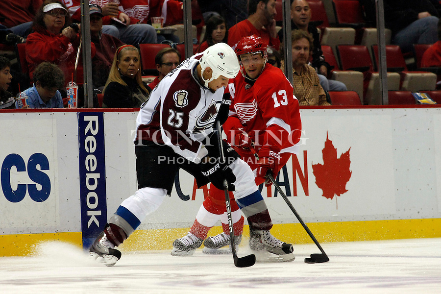 12 October 2010: Colorado Avalanche forward Chris Stewart (25) tries to keep the puck away from Detroit Red Wings forward Pavel Datsyuk (13) in the first period of the Colorado Avalanche at Detroit Red Wings NHL hockey game, at Joe Louis Arena, in Detroit, MI...***** Editorial Use Only *****