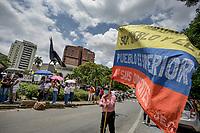 CALI - COLOMBIA, 08-05-2021: Un hombre ondea una bandera de Colombia durante la misa en la glorieta de La Portada en donde manifestantes y habitantes del sector en Cali Colombia se congregaron hoy, 09 mayo de 2021, durante el doceavo día de protestas del Paro Nacional convocado por la reforma tributaria y de la salud que adelanta el gobierno de Ivan Duque además de la precaria situación social y económica que vive Colombia. Durante el día se presentaron bloqueos intermitentes y además recibieron el apoyo de la Minga Indígena. El paro fue convocado por sindicatos, organizaciones sociales, estudiantes y la oposición y sumando el día del trabajo lleva 11 días de marchas y protestas. / A man waver a Colombian flag during a mass in the roundabout of La Portada where protesters and inhabitants of the sector in Cali Colombia gathered today, May 09, 2021, during the twelfth day of protests of the National Strike called for the tax and health reform carried out by the government of Ivan Duque in addition to the precarious situation social and economic life in Colombia. During the day there were intermittent blockades and they also received the support of the Indigenous Minga. The strike was called by unions, social organizations, students and the opposition and adding up to Labor Day it has been 11 days of marches and protests. Photos: VizzorImage / Gabriel Aponte / Staff