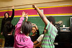 Elementary School afterschool program social emotional learning affirmation trust exercise for group of students, adult guiding process