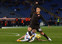 Calcio, Tim Cup: Roma vs Empoli. Ottavi di finale a gara unica. Roma, stadio Olimpico, 20 gennaio 2015.<br /> Roma's Leandro Paredes is fouled by Empoli's Piotr Zielinski, bottom, during the Italian Cup round of 16 football match between Roma and Empoli at Rome's Olympic stadium, 20 January 2015.<br /> UPDATE IMAGES PRESS/Riccardo De Luca