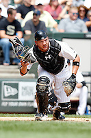 Chicago White Sox catcher Tyler Flowers #17 looks to first after blocking a ball in the dirt during a game against the Kansas City Royals at U.S. Cellular Field on August 14, 2011 in Chicago, Illinois.  Chicago defeated Kansas City 6-2.  (Mike Janes/Four Seam Images)