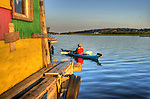 Kayak beside houseboat in Yellowknife Bay
