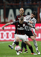 Calcio, Serie A: Milan vs Juventus. Milano, stadio San Siro, 9 aprile 2016. <br /> AC Milan's Juraj Kucka, left, is challenged by Juventus' Alvaro Morata during the Italian Serie A football match between AC Milan and Juventus at Milan's San Siro stadium, 9 April 2016.<br /> UPDATE IMAGES PRESS/Isabella Bonotto