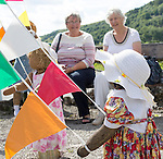Scarecrow Festival at Kettlewell in Yorkshire 2013<br /> <br /> Children around the Maypole are not running very fast<br /> <br /> Scarecrows are made by local community and places in and around their front gardens.  Competition is fierce but it's all to raise money  for the local church  and other local projects to benefit the whole community.<br /> <br /> <br /> <br /> Picture by Gavin Rodgers/ Pixel 8000 <br /> <br /> 07917221968