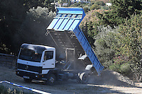"""Pictured: A tipper lorry helps special forensics police officers search a field in Kos, Greece. Tuesday 27 September 2016<br /> Re: Police teams searching for missing toddler Ben Needham on the Greek island of Kos have said they are """"optimistic"""" about new excavation work.<br /> Ben, from Sheffield, was 21 months old when he disappeared on 24 July 1991 during a family holiday.<br /> Digging has begun at a new site after a fresh line of inquiry suggested he could have been crushed by a digger.<br /> South Yorkshire Police (SYP) said it continued to keep an """"open mind"""" about what happened to Ben."""