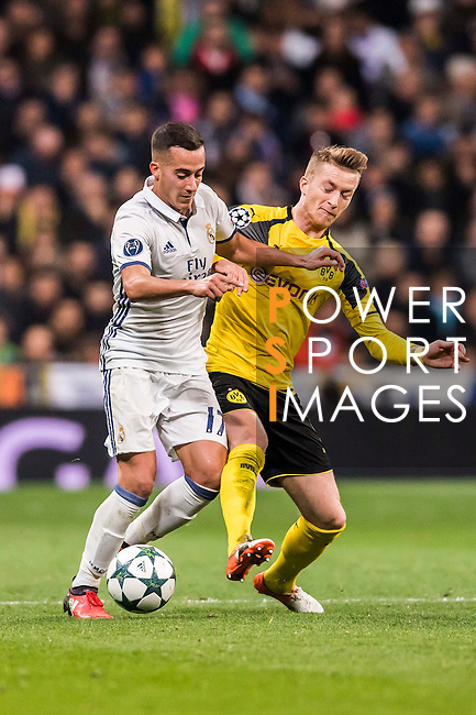 Lucas Vazquez (l) of Real Madrid battles for the ball with Marco Reus of Borussia Dortmund during the 2016-17 UEFA Champions League match between Real Madrid and Borussia Dortmund at the Santiago Bernabeu Stadium on 07 December 2016 in Madrid, Spain. Photo by Diego Gonzalez Souto / Power Sport Images