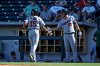 Surprise Saguaros right fielder LaMonte Wade (15), of the Minnesota Twins organization, is congratulated by Chris Paul (21) after hitting a home run during an Arizona Fall League game against the Mesa Solar Sox on October 20, 2017 at Sloan Park in Mesa, Arizona. The Solar Sox walked-off the Saguaros 7-6.  (Zachary Lucy/Four Seam Images)