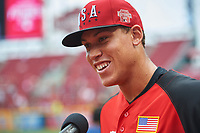 Team USA Aaron Judge (99) does an interview during practice before the MLB All-Star Futures Game on July 12, 2015 at Great American Ball Park in Cincinnati, Ohio.  (Mike Janes/Four Seam Images)