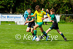 Fionn Daly of Kerry in possession despite the attention fromJack Fitzgerald and Alex Burchill of Limerick County in the 2021 Kennedy Cup game