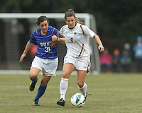 Boston College forward Stephanie McCaffrey (9) on the attack as Duke University defender Christina Gibbons (31) defends.Boston College (white) defeated Duke University (blue/white), 4-1, at Newton Campus Field, on October 6, 2013.
