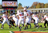 Oct. 22, 2011 - Charlottesville, Virginia - USA; North Carolina State Wolfpack quarterback Mike Glennon (8) hands off to North Carolina State Wolfpack running back James Washington (24) during an NCAA football game against the Virginia Cavaliers at the Scott Stadium. NC State defeated Virginia 28-14. (Credit Image: © Andrew Shurtleff