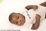 5 month old baby boy on back closeup portrait horizontal African American