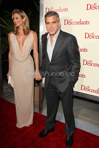 Stacy Keibler and George Clooney at the Los Angeles Premiere of 'The Descendants' at AMPAS Samuel Goldwyn Theater on November 15, 2011 in Beverly Hills, California © mpi21/MediaPunch Inc.