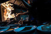 Chefs work in the kitchen of Chef Tatung's restaurant, Alab in Quezon City in Manila in the Philippines. Photograph: Sanjit Das/Panos for Greenpeace