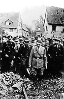 Adolf Hitler, accompanied by other German officials, grimly inspects bomb damage in a German city in 1944, in this German film captured by the U.S. Army Signal Corps on the western front. Ca. 1944.  (Army)<br /> Exact Date Shot Unknown<br /> NARA FILE #:  111-SC-197660<br /> WAR & CONFLICT BOOK #:  1088