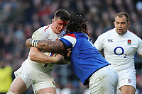 Tom Curry of England, with his face covered in blood, is tackled by Mathieu Bastareaud of France during the Guinness Six Nations match between England and France at Twickenham Stadium on Sunday 10th February 2019 (Photo by Rob Munro/Stewart Communications)