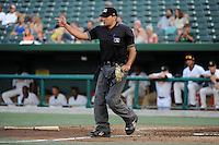 Umpire Charlie Ramos makes a call during a game between the South Bend Silver Hawks and Bowling Green Hot Rods on August 20, 2013 at Stanley Coveleski Stadium in South Bend, Indiana.  Bowling Green defeated South Bend 3-2.  (Mike Janes/Four Seam Images)