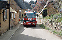 Fire engine speeding to an emergency call in a rural location. This image may only be used to portray the subject in a positive manner..©shoutpictures.com..john@shoutpictures.com