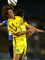8 September 2004: Todd Dunivant of Earthquakes battles for the ball in the air with Duncan Oughton of Crew at Spartan Stadium in San Jose, California.  Crew defeated Earthquakes, 1-0.  Credit: Michael Pimentel / ISI