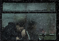 A man is seen a bus during a heavy temporal in Madrid on January 7, 2010. (c) PEDRO ARMESTRE