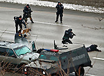 standoffp3, mjs, news - After throwing in a can of tear gas and forcing the suspect out of the car, the tactical team apprehends him on I-94 westbound after a six hour standoff, in Milwaukee on Friday, December 10, 2010. PHOTO BY MARK ABRAMSON/MABRAMSON@JOURNALSENTINEL.COM