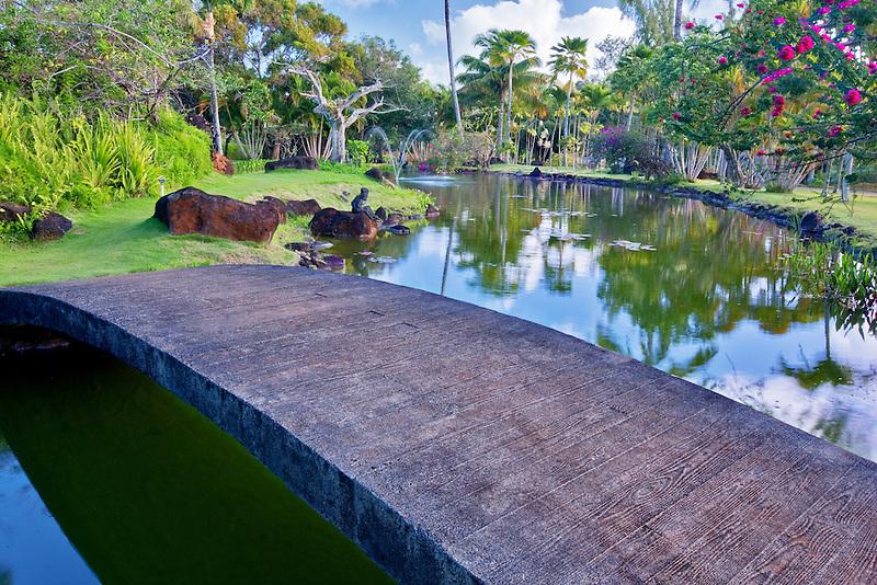 Bridge and pond and garden at Na Aina Kai Botanical Gardens. Kauai, Hawaii