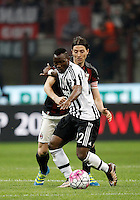 Calcio, Serie A: Milan vs Juventus. Milano, stadio San Siro, 9 aprile 2016. <br /> Juventus' Kwadwo Asamoah, foreground, is challenged by  AC Milan's Riccardo Montolivo during the Italian Serie A football match between AC Milan and Juventus at Milan's San Siro stadium, 9 April 2016.<br /> UPDATE IMAGES PRESS/Isabella Bonotto