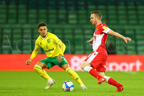 3rd November 2020; Carrow Road, Norwich, Norfolk, England, English Football League Championship Football, Norwich versus Millwall; Shane Ferguson of Millwall under pressure from Max Aaron of Norwich City