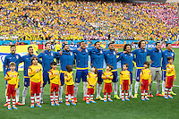 The Brazil team sing during their national anthem