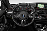 Car pictures of steering wheel view of a 2020 BMW M4 Base 2 Door Convertible