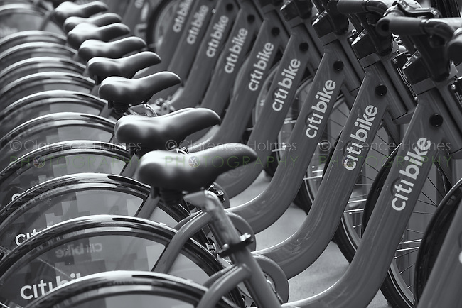 Public bicycles of the Citi Bike NYC bike sharing program wait in their docking stations for the next riders.