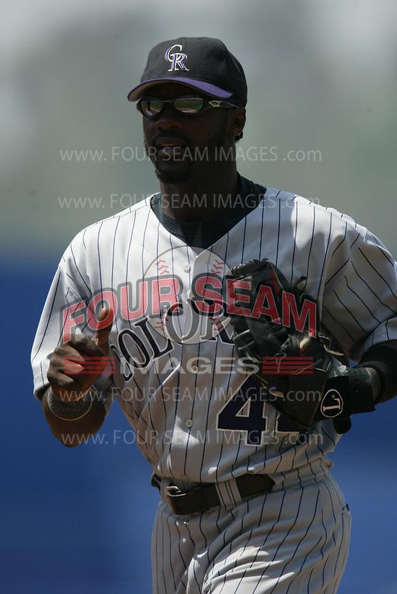 Preston Wilson of the Colorado Rockies during a 2003 season MLB game at Dodger Stadium in Los Angeles, California. (Larry Goren/Four Seam Images)