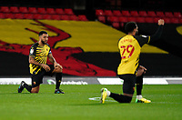 Troy Deeney of Watford takes a knee during the Sky Bet Championship behind closed doors match played without supporters with the town in tier 4 of the government covid-19 restrictions, between Watford and Norwich City at Vicarage Road, Watford, England on 26 December 2020. Photo by Andy Rowland.