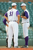 Winston-Salem Dash pitching coach Bobby Thigpen #37 has a chat with starting pitcher Terry Doyle #34 at  BB&T Ballpark June 27, 2010, in Winston-Salem, North Carolina.  Photo by Brian Westerholt / Four Seam Images