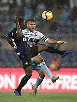 Calcio, Serie A: SS Lazio vs Internazionale Milano, Olympic stadium, Rome, October 29, 2018.<br /> Lazio's Ciro Immobile (r) in action with Inter's Kwadwo Asamoah (l) during the Italian Serie A football match between SS Lazio and Inter Milan at Rome's Olympic stadium, on October 29, 2018.<br /> UPDATE IMAGES PRESS/Isabella Bonotto