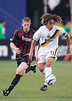 John Wolyniec of the MetroStars chases Cobi Jones as  Jones and the rest of the Galaxy were shutout as the LA Galaxy lost to the NY/NJ MetroStars 1-0 on 6/21/03 at Giant's Stadium, NJ.