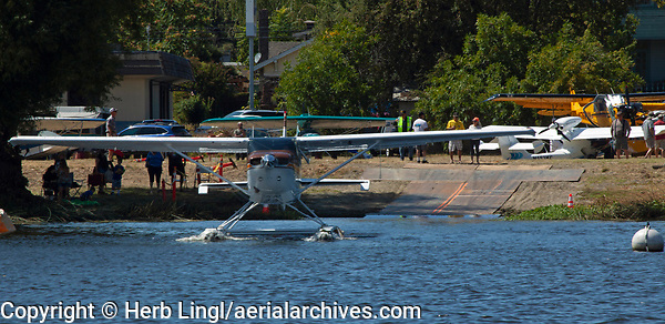 Cessna 206, TU206G, N247CB, taxis for takeoff at the Clear Lake Seaplane Splash-In, Lakeport, Lake County, California