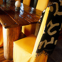 Detail of the refectory table in the dining room which was made from the timber of a beached dhow with its mast used for the legs