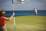 Couple golfing at Winding Bay, Great Abaco, Bahamas Out Islands