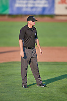 Umpire Pete Talkington handles the calls on the bases during a game between the Ogden Raptors and the Orem Owlz at Lindquist Field on August 3, 2018 in Ogden, Utah. The Raptors defeated the Owlz 9-4. (Stephen Smith/Four Seam Images)