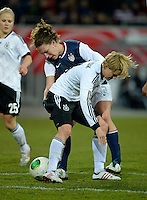 Offenbach, Germany, Friday, April 05 2013: Womans, Germany vs. USA, in the Stadium in Offenbach,   Lauren Cheney (USA), Saskia Bartusiak (GER)..