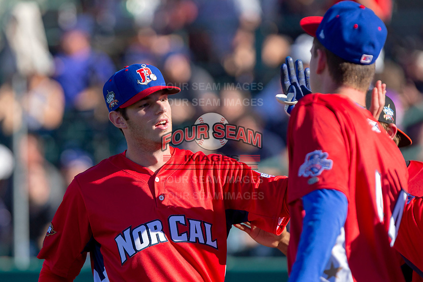 Jonah Heim (13) of the Stockton Ports participates in the Home Run Derby prior to the 2018 California League All-Star Game at The Hangar on June 19, 2018 in Lancaster, California. The North All-Stars defeated the South All-Stars 8-1.  (Donn Parris/Four Seam Images)