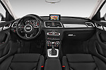 Stock photo of straight dashboard view of a 2015 Audi Q3 Sport 5 Door SUV