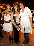 From left: Madeline Thomeer, Kelli Gallegos and Mina Covington at the Cattle Baron's Ball at the George Ranch Saturday April 24,2010.. (Dave Rossman Photo)