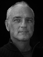 Portrait made using ultraviolet light of VII photographer Stefano De Luigi.