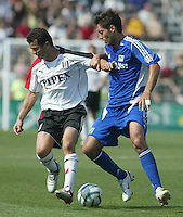 Fulham FC's Tomasz Radzinski (left) and Major League Soccer's Clint Dempsey (right) battle for the ball during the MLS All Star game in Columbus, Ohio Saturday, July 30, 2005.