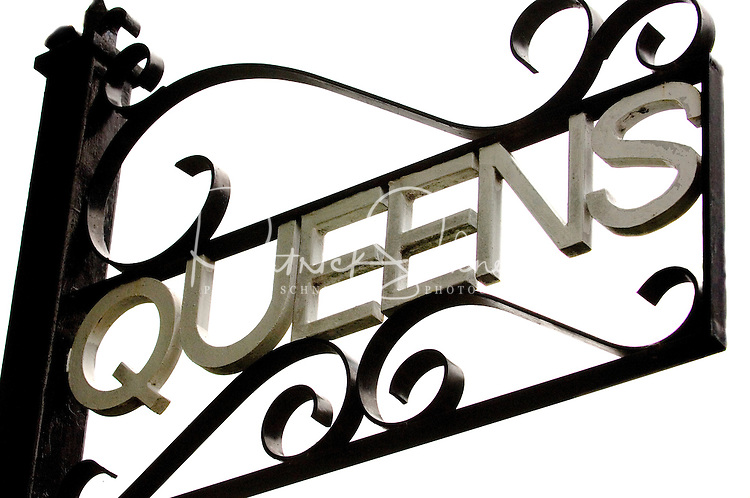 A sign spelling out QUEENs in the Myers Park neighborhood in Charlotte, NC. Myers Park is one of the premier neighborhoods in North America and known for its large canopy of trees.