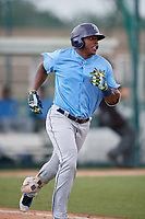 Tampa Bay Rays right fielder Moises Gomez (70) runs to first base during an Instructional League game against the Pittsburgh Pirates on October 3, 2017 at Pirate City in Bradenton, Florida.  (Mike Janes/Four Seam Images)