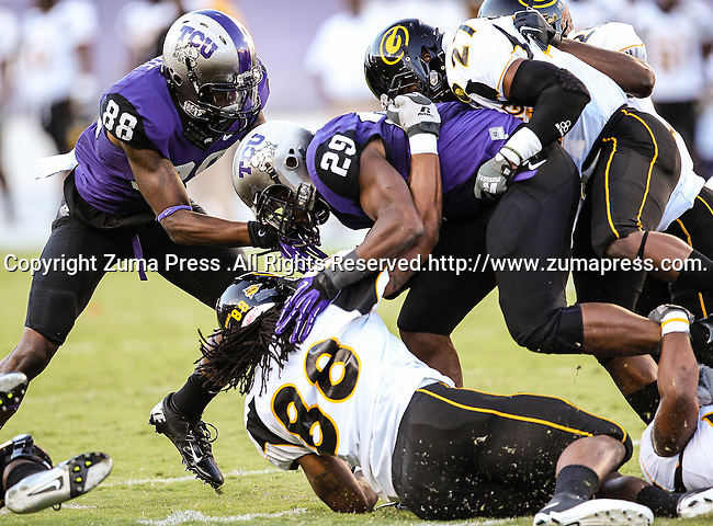 TCU Horned Frogs wide receiver Cam White (88), TCU Horned Frogs running back Matthew Tucker (29) and Grambling State Tigers defensive end Eric Harper (88) in action during the game between the Grambling State Tigers and the TCU Horned Frogs  at the Amon G. Carter Stadium in Fort Worth, Texas. TCU defeats Grambling State 59 to 0.